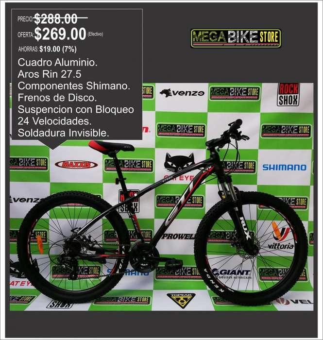 Bicicleta Marca GTI Rin 27.5 , cuadro aluminio soldadura invisible , suspencion con Bloqueo , SHIMANO. NROJO