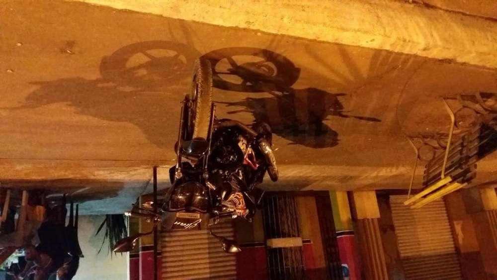 Vendo por necesidad moto pulsar 135 ao 2013 en buen estado