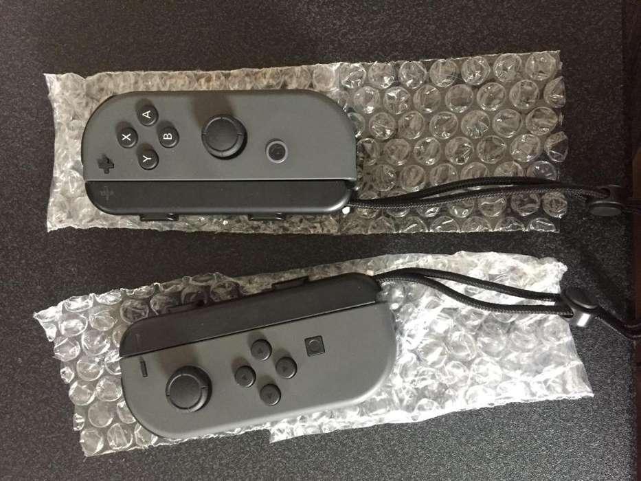 Joy cons y cargador nintendo switch