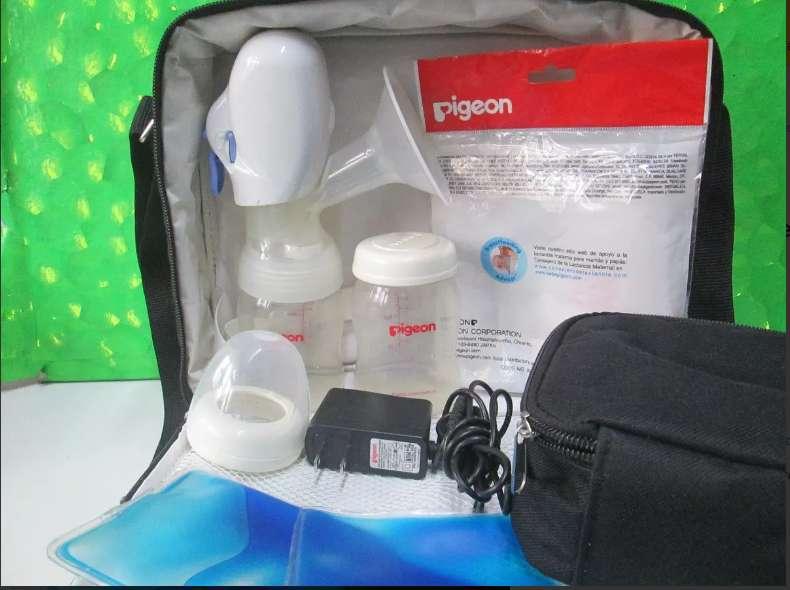 extractor de leche electrico y pilas almohadillas nuevo