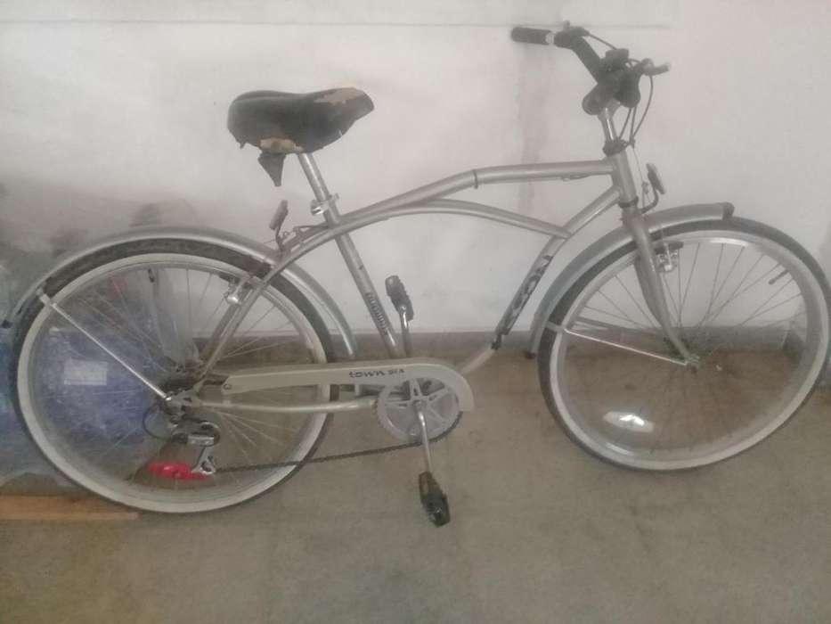 Bicicleta tipo playera rodado 26 con cambios y frenos al volante de serie
