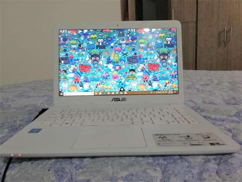 Laptop ASUS E402SA: Procesador Intel Pentium, N3050, Ram 4Gb, Disco duro 500 Gb excelente para la universidad.