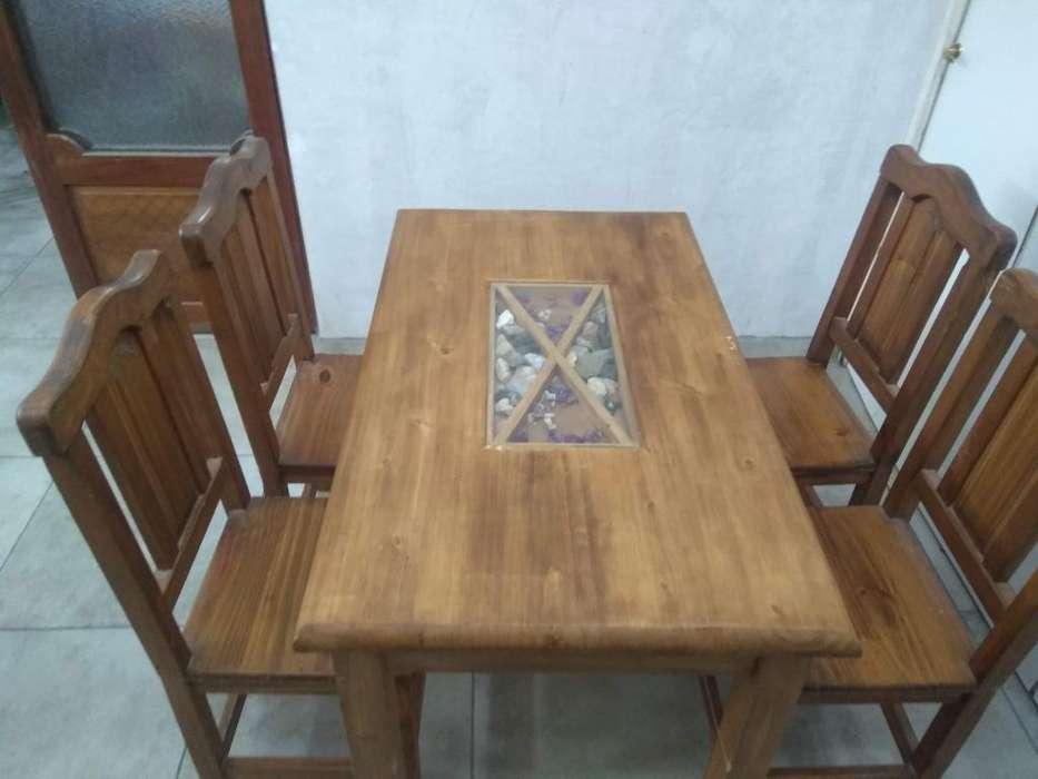 Vendo juego usado de mesa alamo y 4 sillas.