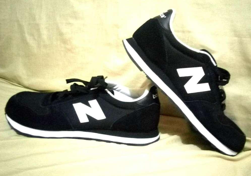 Vendo Zapatillas NEW BALANCE negra con blanca a 320 soles