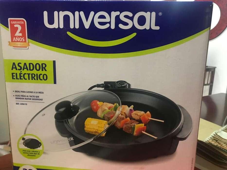 vendo asador marca universal para estrenar