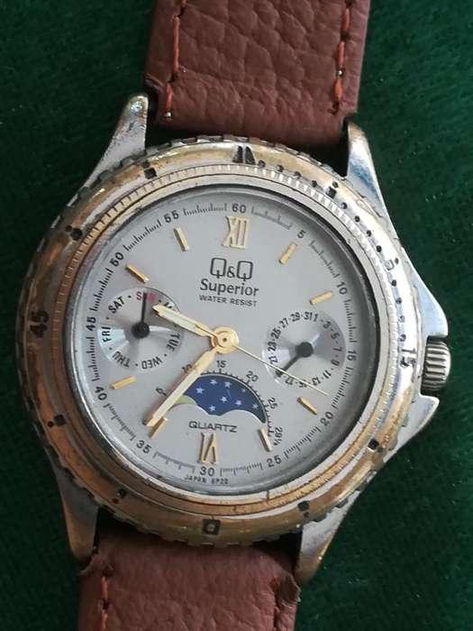 Reloj Q Q Superior Fases Lunares