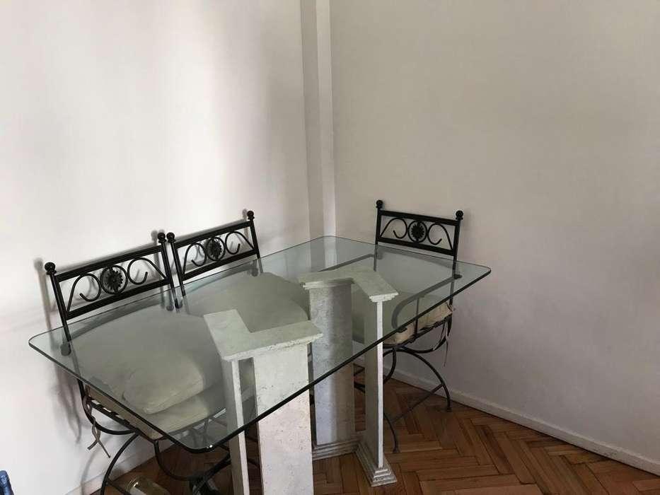 Mesa de base de mrmol travertino y vidrio
