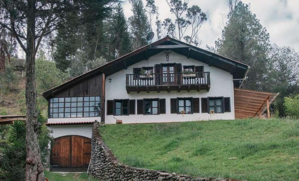 Venta Casa con 1 hectarea de terreno en Cuenca Ecuador