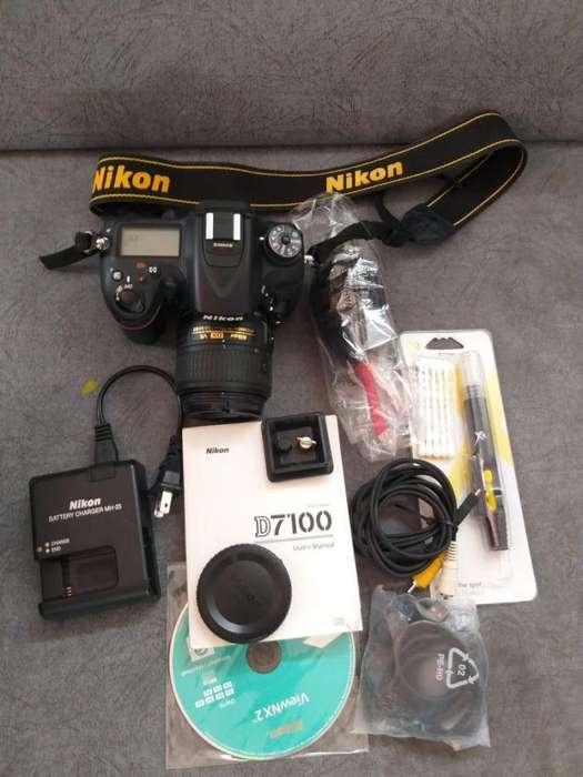 Cámara Nikon D7100 con Lente 18-55mm, manual, <strong>cargador</strong>, CD, kit de limpieza