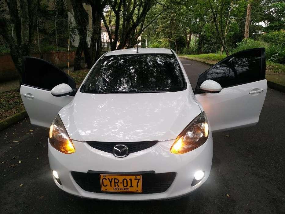 Mazda 2 2008 - 100000 km