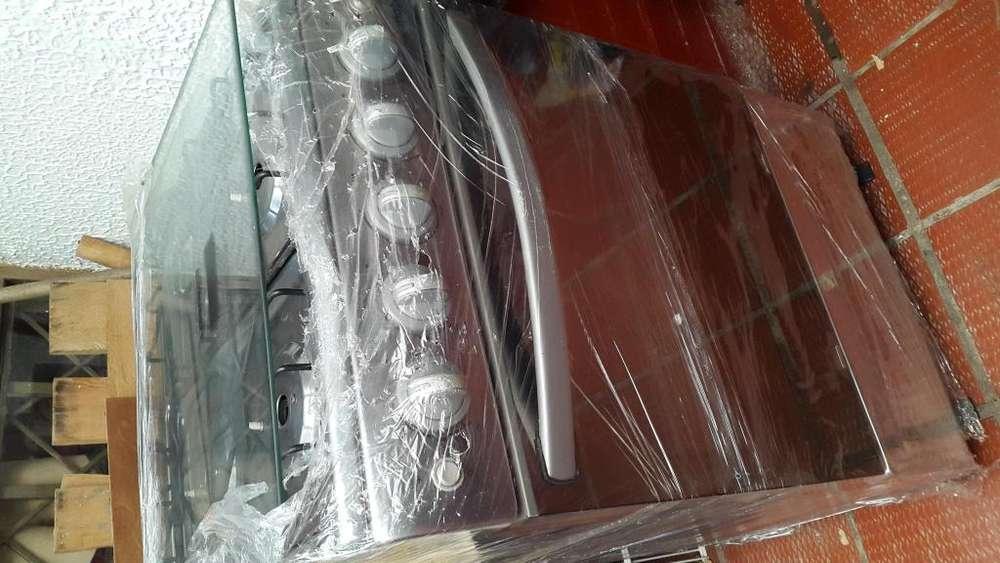 Estufa Mabe TX16 4 CON Cocina Autosoportable poco uso Eelectrico