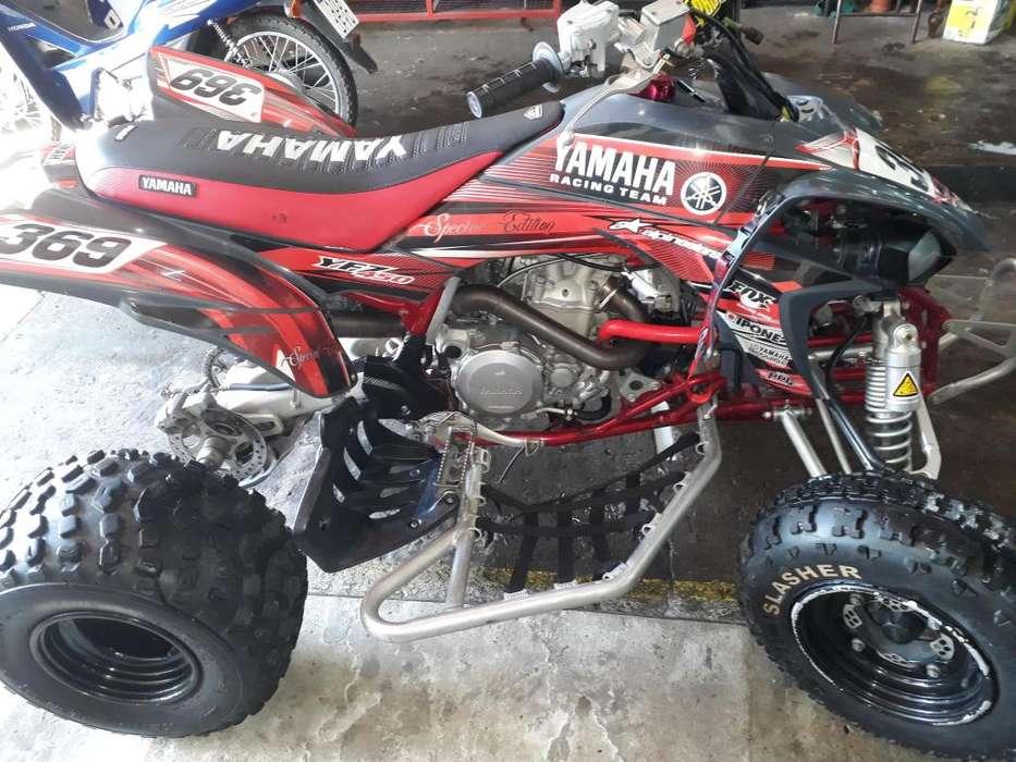 vendo cuatriciclo Yamaha YFZ 450 acepto moto japon en parte de pago