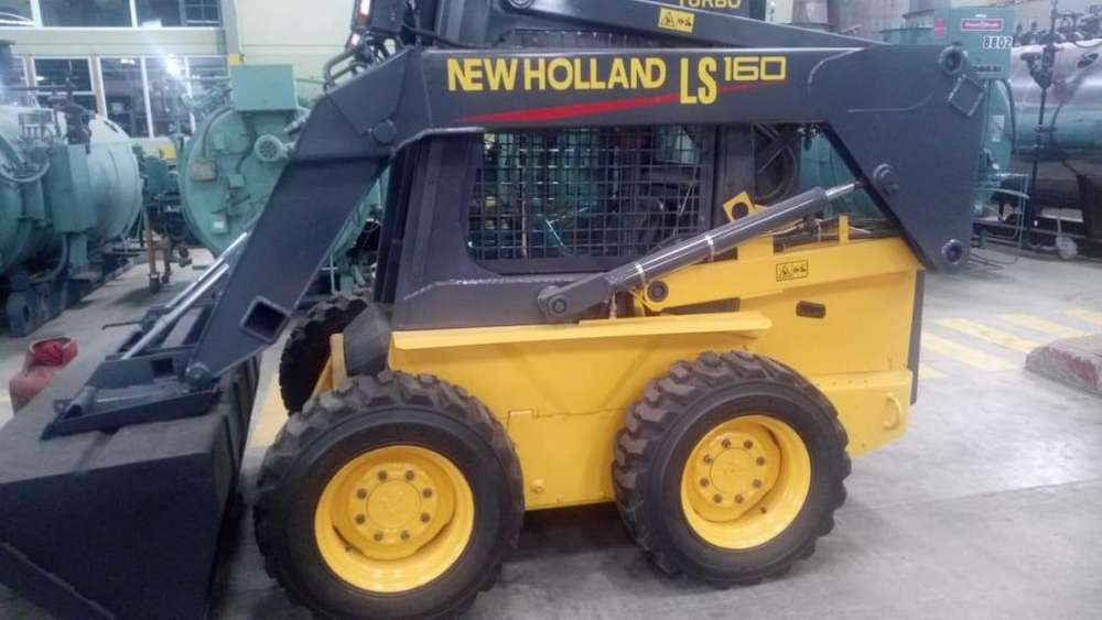 Minicargadora New holland modelo LS160 en muy buen estado año 2002