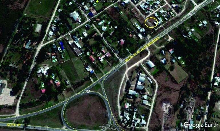 Lote sobre colectora ruta 12 frente a la ruta