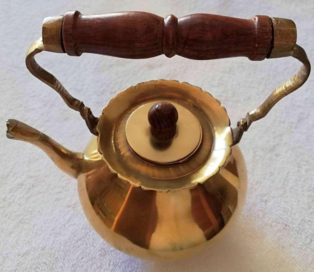Antigua pava de bronce