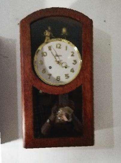Reloj de pared campanero