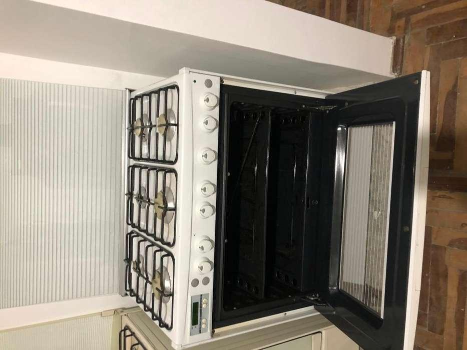 <strong>cocina</strong> seis hornillas a gas gril horno usada sin grasa 0983412804