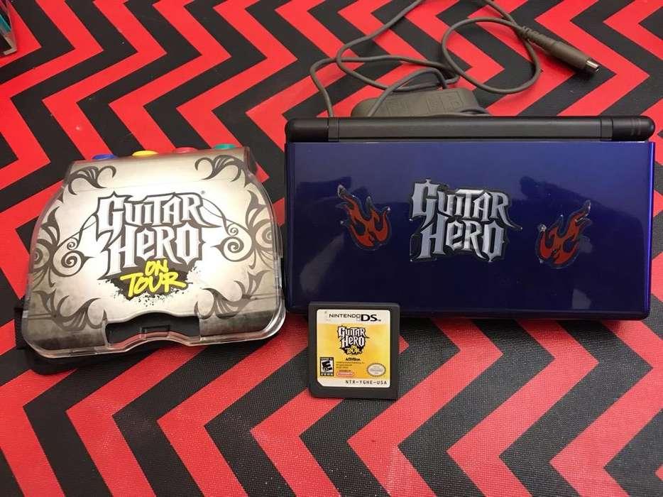 Nintendo Ds con Juego de Guitar Hero.