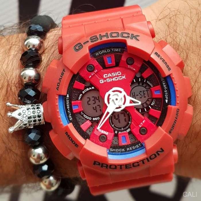Se vende Casio G-Shock rojo mate con detalles blancos y azules, hora digital y analogo para hombre