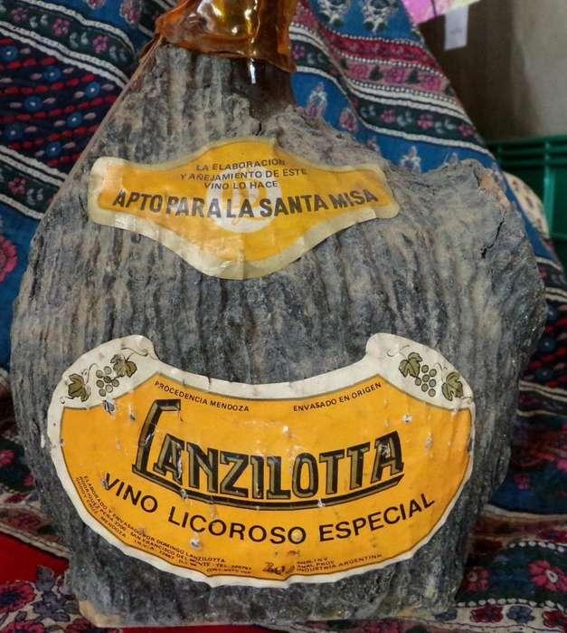 Botella labrada vino licoroso Lanzilotta década del 70