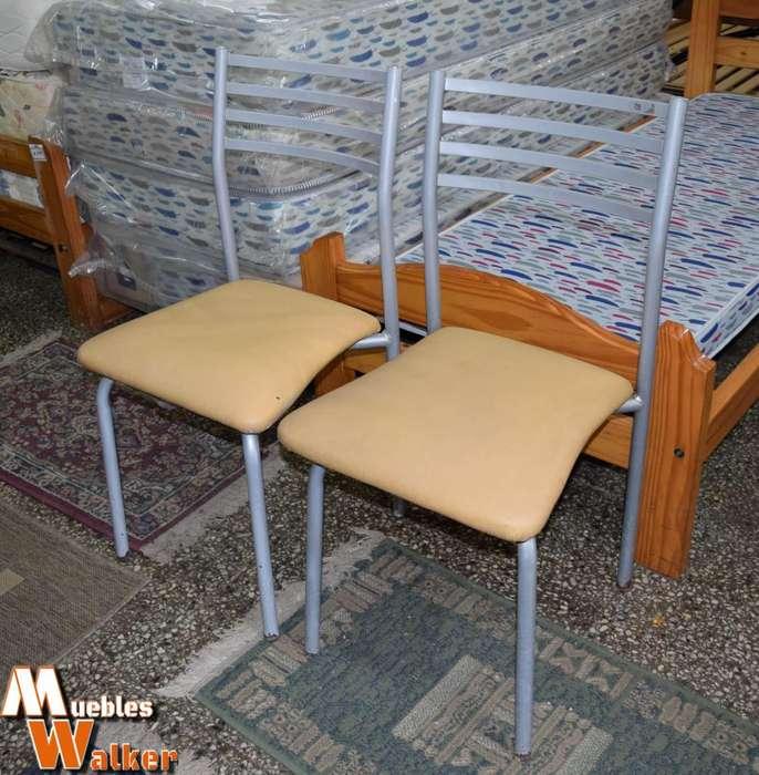 2 Sillas de caño Simet con asiento tapizado