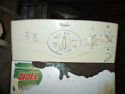 lavarropas de 4 kg.de ropa marca whirpool carga superior.info adentro