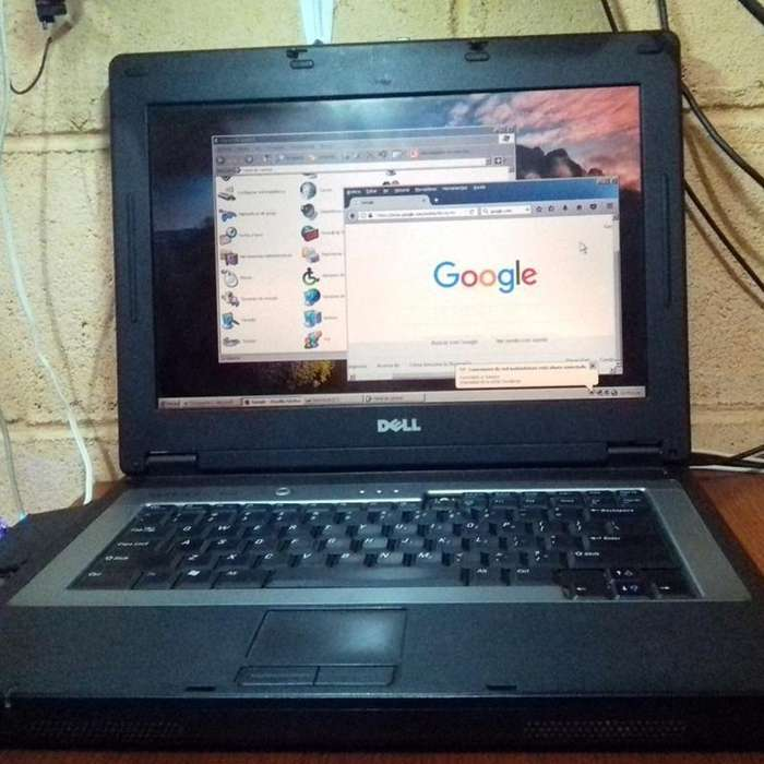 Laptop grande Dell 120B con 100gb disco duro, 2gb de ram WINDOWS XP Office 2010 ya lista para trabajar
