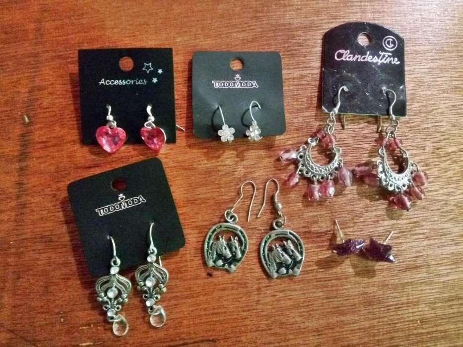 Accesorios: Aros, collares, hebilla, anillo, brazalete, pulseras y vincha