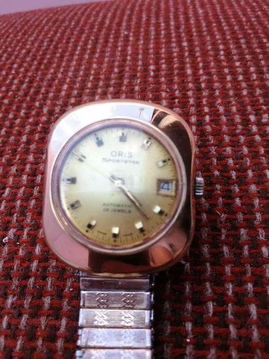Reloj Oris, Laminado 10 Micrones Automat