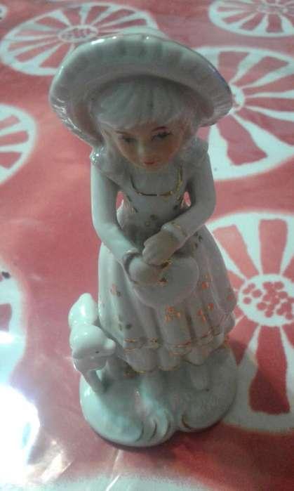 muñeca estatuilla ceramica