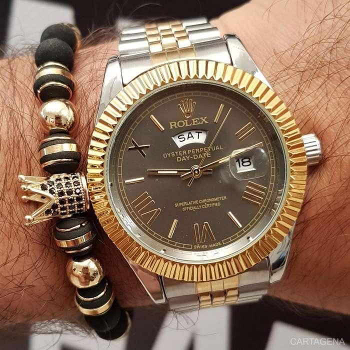 Rolex plateado con dorado y fondo gris para hombre en venta