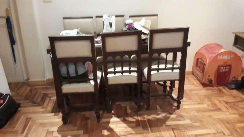 Juego de <strong>comedor</strong> estilo español moderno: mesa, 6 sillas y 2 sillones
