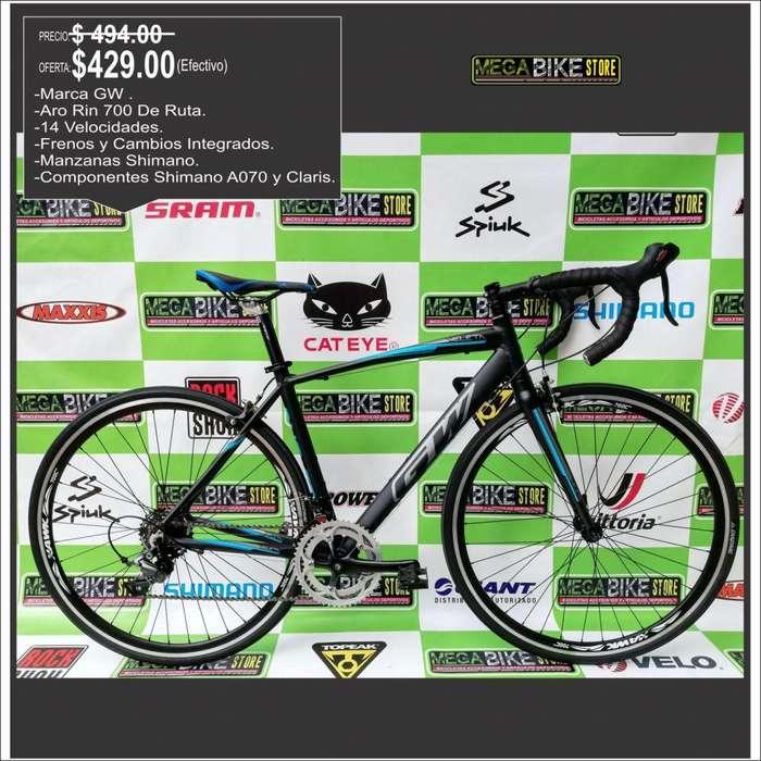 Bicicleta de Ruta Aro 700c aluminio marca GW , componentes shimano claris y A070, 7v, rutera rin 700
