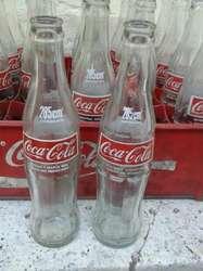 Vendo 24 botellitas de coca cola 285 cm3 con cajon  450