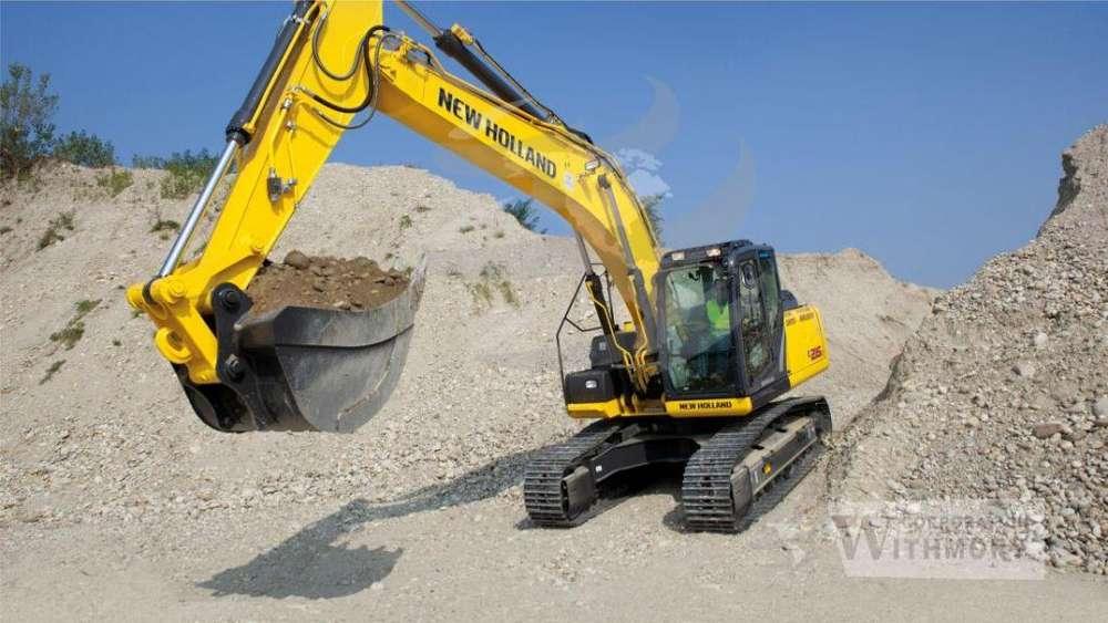 Tractor – Excavadora New Holland E215C.