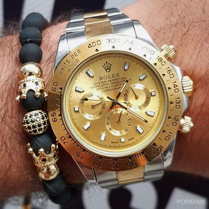 h) Rolex bicolor funcional fondo dorado 130 hombres