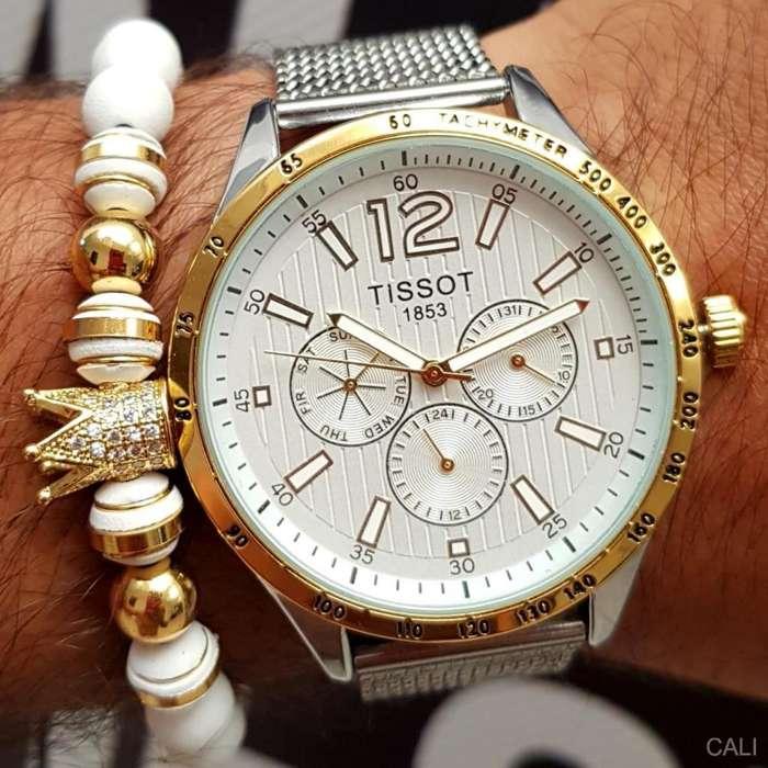 Reloj Tissot en color plateado con dorado para caballero