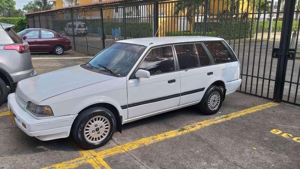 Mazda 323 1996 - 13500 km