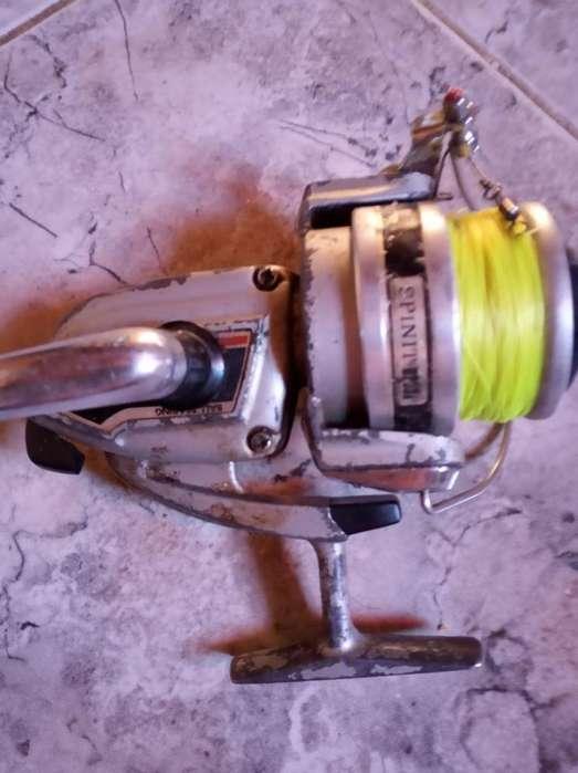 Vendo reel Spinit 6200a con tanza nueva