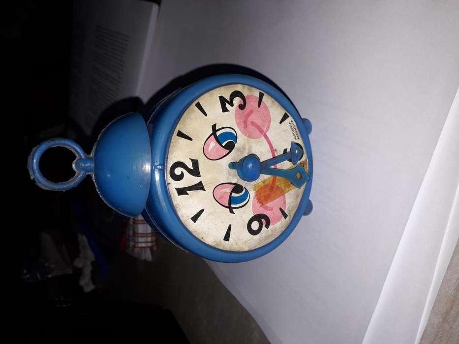 reloj alcancia de plastico soplado