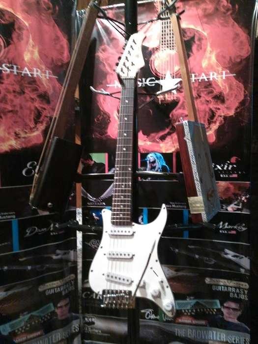 guitarra viajera strato pickguardfunda y pua de regaloenvios!!!!