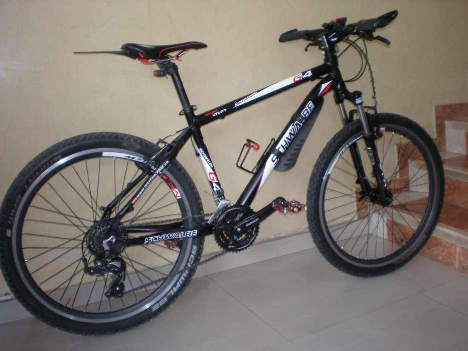 VENDO bicicleta SCHWALBE aluminio rin 26 talla 17 SHIMANO 2 años garantía