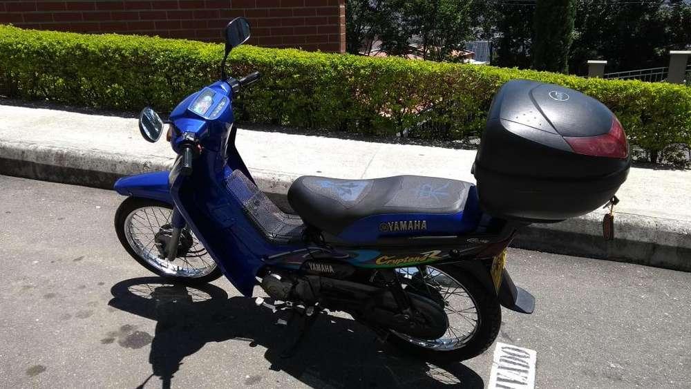 Vendo excelente moto a precio de remate
