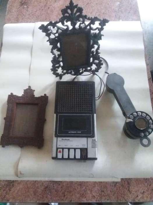 Porta retratos, teléfono y grabador
