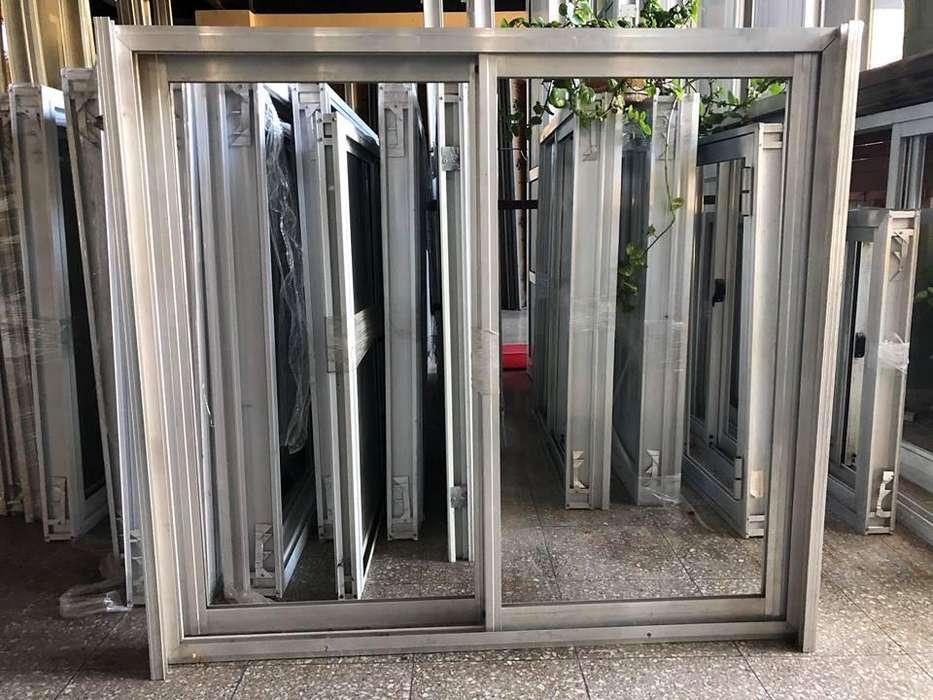 Ventana <strong>aluminio</strong> natural con guia para cortina