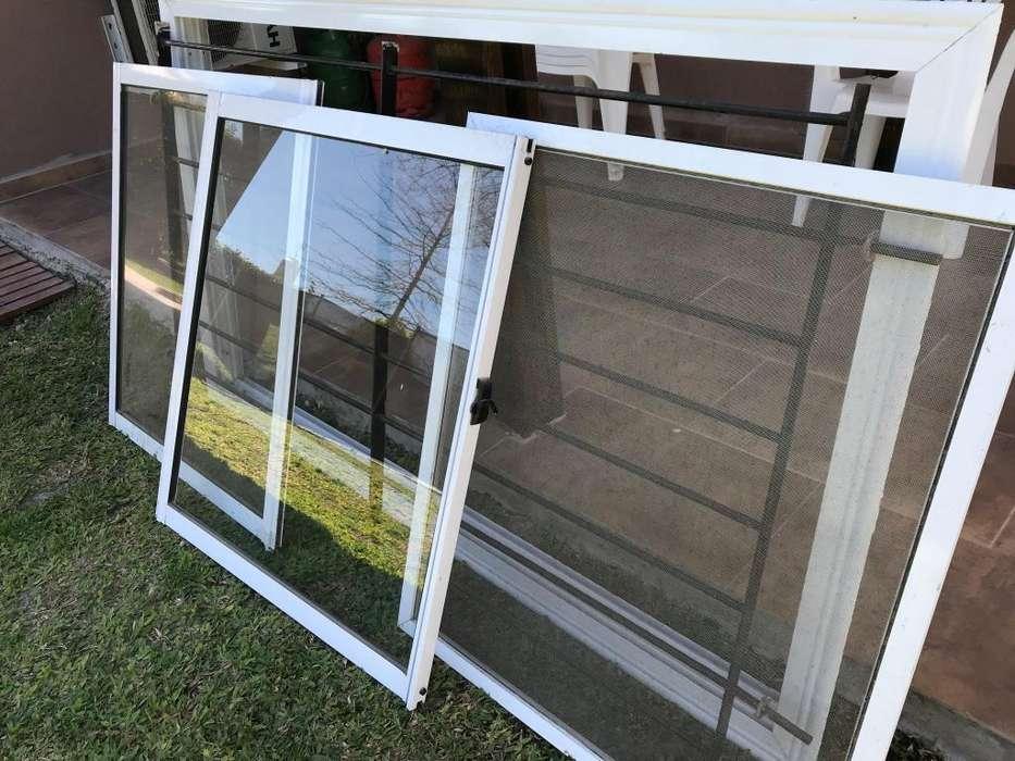 Vendo ventana de 1,50 x 1,10 con rejas y mosquitero