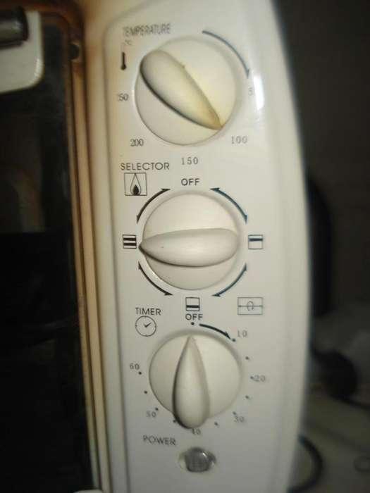 Vendo este excelenteHorno Electrico Yelmo Yl30 funciona perfecto color blanco