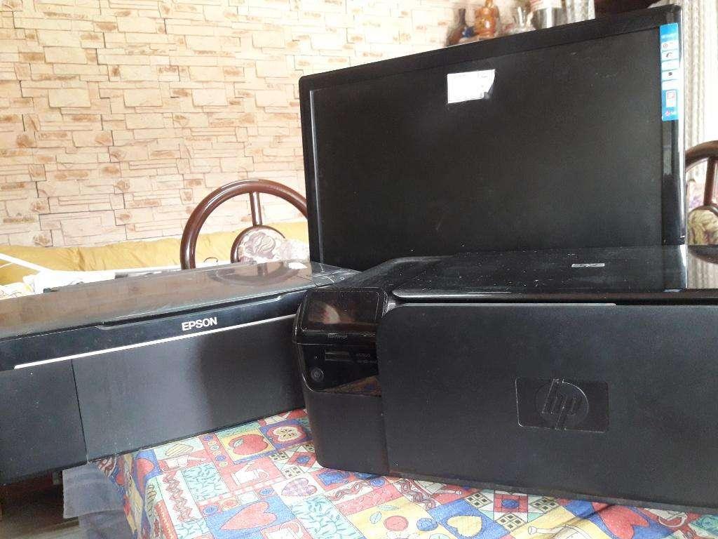 1 Monitor, Dos Impresoras