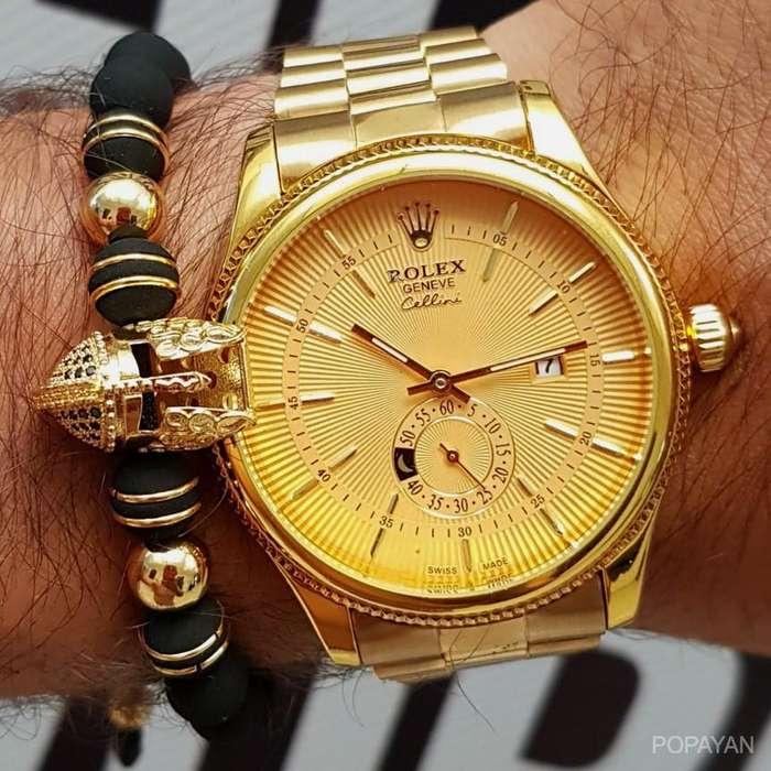 q) Rolex dorado fecha crono 80 hombre