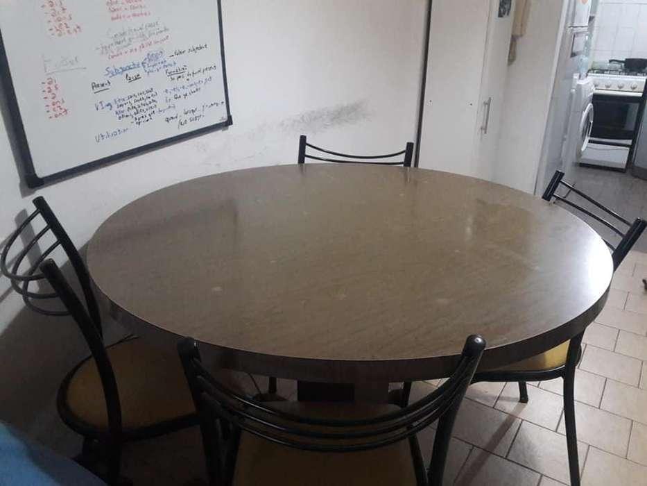 Mesa redonda 6 <strong>silla</strong>s de tubo, vendo por mudanza